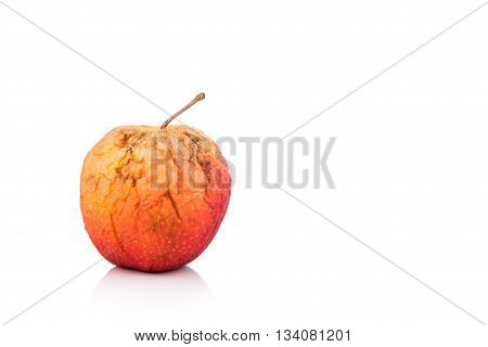 Rotten And Decomposing Red Apple On White Background