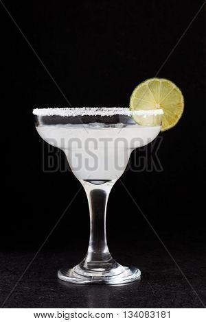 Margarita cocktail in glass on slate background