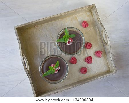 chocolate mousse and raspberry. Rustic style background.