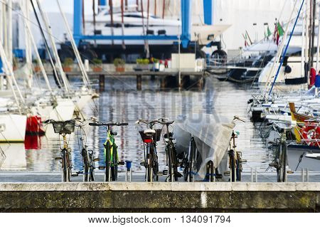 Row of bike parked in the port of viareggio