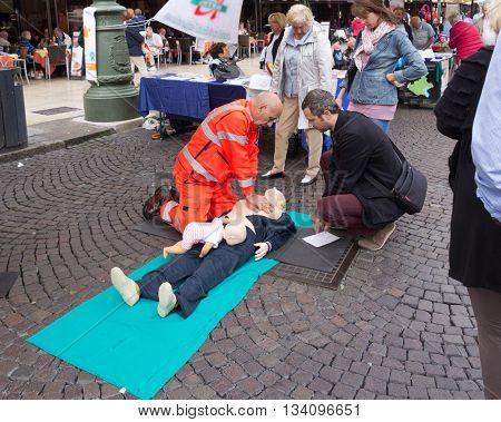 Verona Italy September 27 2015: Representative ambulance conducts classes in the open air on the first aid on Piazza Bra in Verona Italy