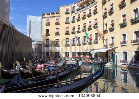 Venice Italy September 28 2015: Parking gondolas in one of the canals of Venice Italy