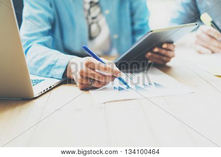 Photo Sales Manager Working Modern Office.Woman Use Generic Design Tablet, Holding Pencil Hand.Account Department Work process New Startup project.Wood Table.Horizontal.Blurred Background.Film effect