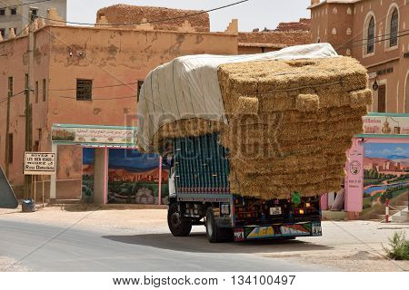 MOROCCO - AUGUST 02: Overloaded truck staying on road August 02 2015 in Atlas Mountains Morocco. Road in Atlas Mountains very popular tourist route in central Morocco.