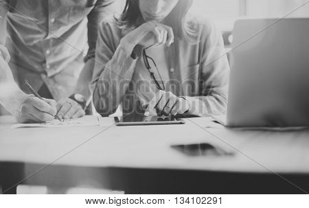 Sales Managers Working Modern Loft.Woman Showing Market Report Digital Tablet.Producer Department Work New Startup Project.Researching Process Wood Table.Horizontal.Blurred.Black White