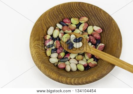 bowl of different haricot beans on a white background