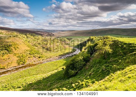 The River Coquet, in Upper Coquetdale Valley winds its way through the Cheviot Hills in Northumberland