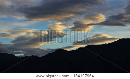 Morning scene in Hawea New Zealand. Beautiful shaped clouds.