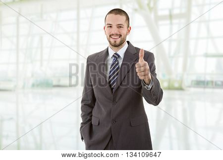 young business man going thumb up, at the office