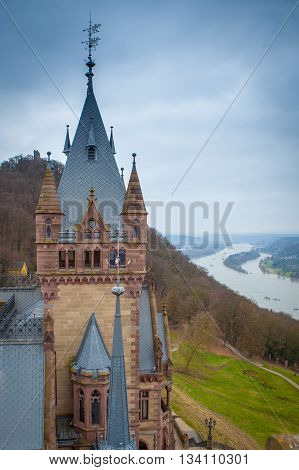 Drachenburg tower with the Danube on a rainy day