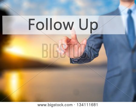 Follow Up - Businessman Hand Pressing Button On Touch Screen Interface.
