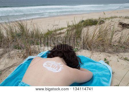Sun Tan Lotion Sun Is Writing On A Woman Back.