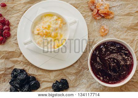 Millet porridge with pumpkin. Parchment background. Flat Lay