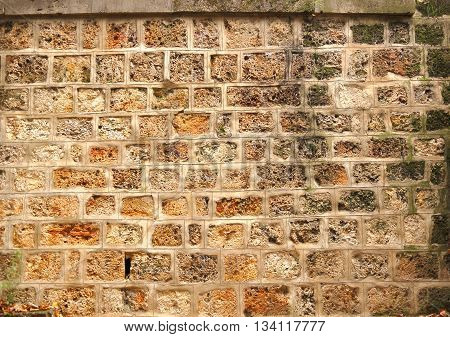 Closeup of old sandstone wall masonry texture