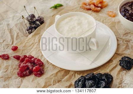 Rice Porridge with Sweet Butter, Jam and Coffee. Breakfast