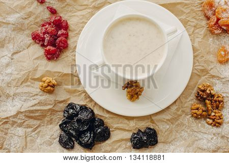 Oat meal with walnuts and berries. Parchment background.