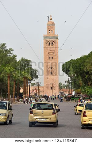MARRAKESH - AUGUST 08: traffic in front of the minaret of the Koutoubia Mosque on August 08 2015 in a Marrakesh Morocco.