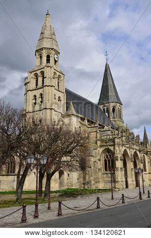 Poissy France - april 4 2016 : the picturesque collegiate church in spring