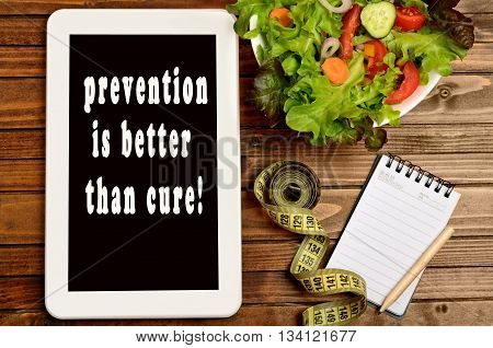 The words Prevention is better than cure on digital tablet pc