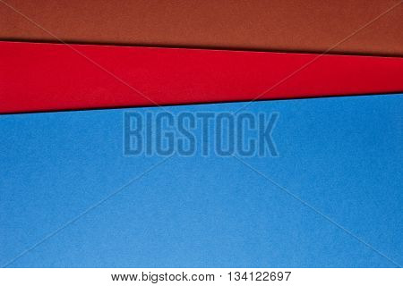 Colored cardboards background in brown red blue tone. Copy space. Horizontal