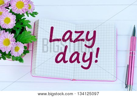 Lazy day words on notebook page closeup