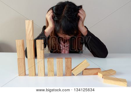 Stressed businesswoman with simulate stock market took a nosedive.