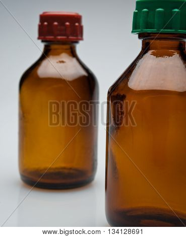 Medical glass jars on a gray background