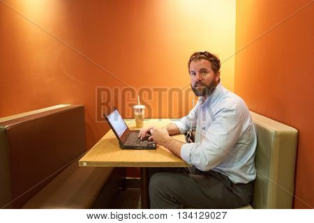 NEW YORK - CIRCA MARCH, 2016: man in McDonald's restaurant. McDonald's is the world's largest chain of hamburger fast food restaurants, founded in the United States.