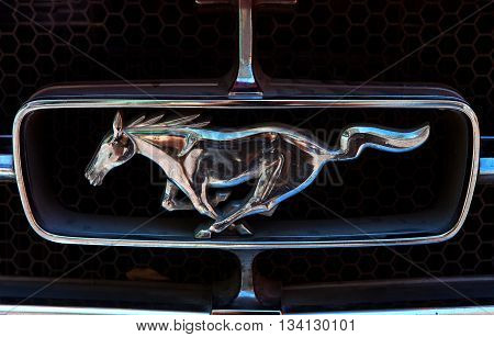 Tel Aviv, Israel, June 12, 2016: Vintage Ford Mustang emblem. Ford Mustang is an American automobile manufactured by Ford, originally based on the platform of the second generation Ford Falcon.