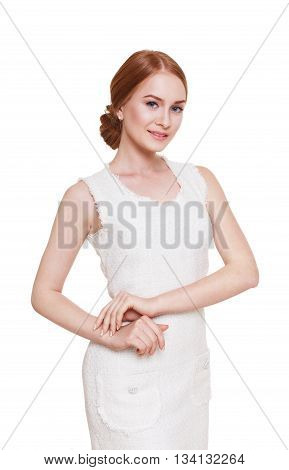 Portrait of a beautiful redhead woman in elegant white dress. Beauty, fashion model isolated at white. Young seductive lady with long hair. Posh, stylish caucasian woman with make up and pale skin