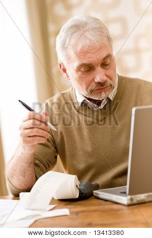 Senior Mature Man - Home Office, Paper Tape Calculator