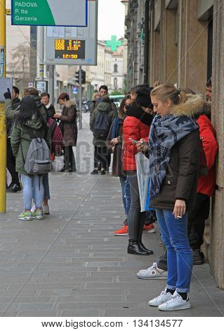 Padua Italy - November 25 2015: people are waiting for bus on stop in Padua Italy