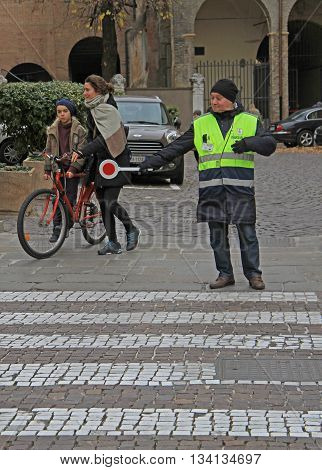Traffic Controller Is Helping To People On Pedestrian Crossing In Padua, Italy