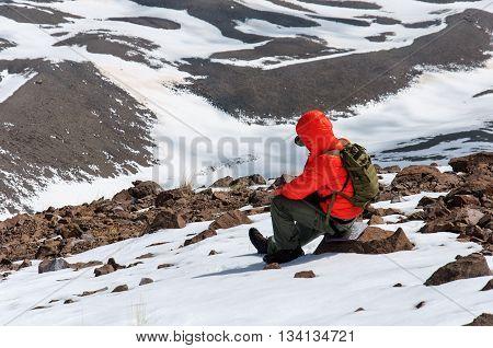 Male climber rises on a snowy volcano. Turkey