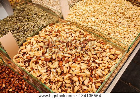 Close-up of different nuts and dried fruits in boxes. The counter on the Mahane Yehuda Market in Jerusalem, Israel.