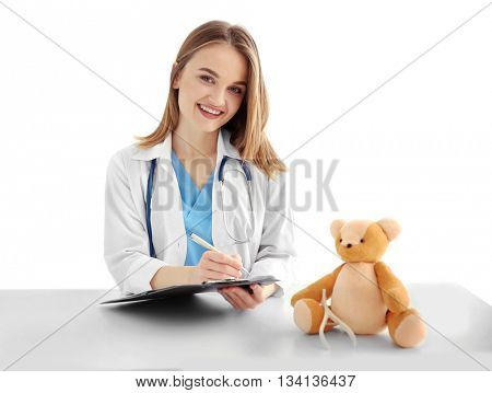 Young beautiful female doctor working at the table