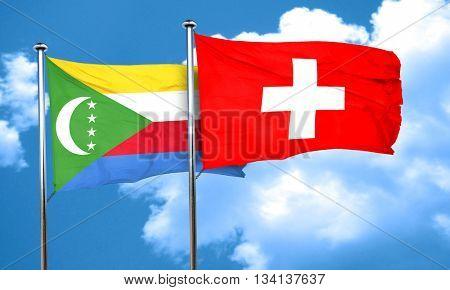 Comoros flag with Switzerland flag, 3D rendering
