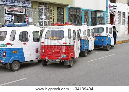 Cajamarca Peru - June 11 2016: Four parked moto-taxis on the street in Cajamarca Peru on June 11 2016