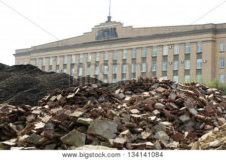 Russian Government building Soviet style with ruins on foreground horizontal