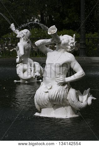 Beautiful sculptured fountains features of the historic Forsyth Park Fountain in Savannah, Georgia