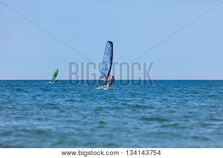Windsurfer With Windsurf On Sea Waves