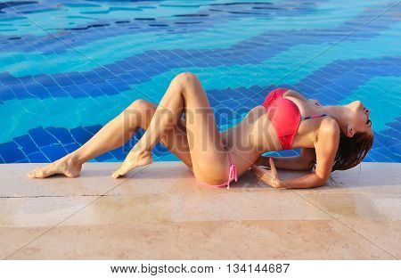 Sexy Model Wearing Bikini By The Pool