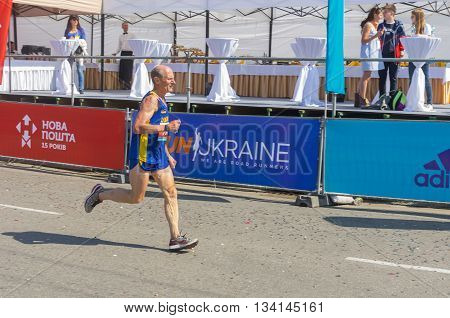 DNEPR UKRAINE - MAY 21 2016:Senior participant hurrying to finish line during