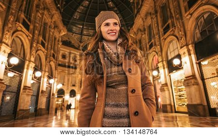 Happy Woman In Galleria Vittorio Emanuele Ii And Looking Aside