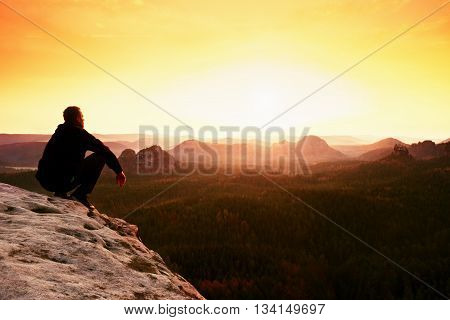 Hiker Sit On Cliff And Enjoing Spring View In Mountains