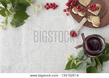 red currant, toast and jam on white background textile