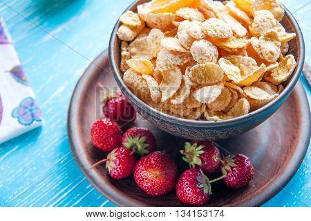 Healthy breakfast. Cornflakes and fresh strawberry closeup