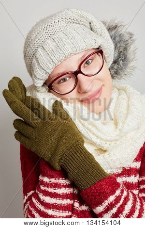 Atractive young woman wearing a scarf and a cap in winter