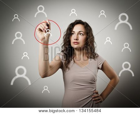 Young woman is writing in social network. One person selection.