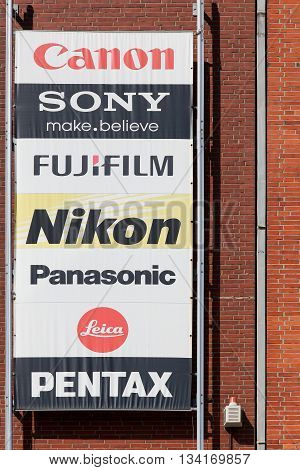 Kiel, Germany - June 4, 2016: The main brands of the photography market on a wall of a store